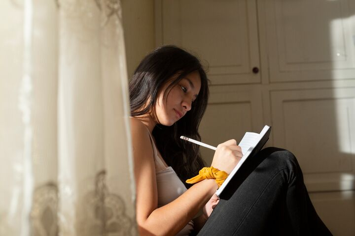 Woman writing down affirmations